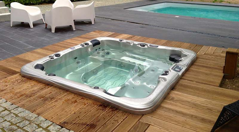 Thinking of sinking your hot tub into the deck sutton spas for How to build a sunken bathtub